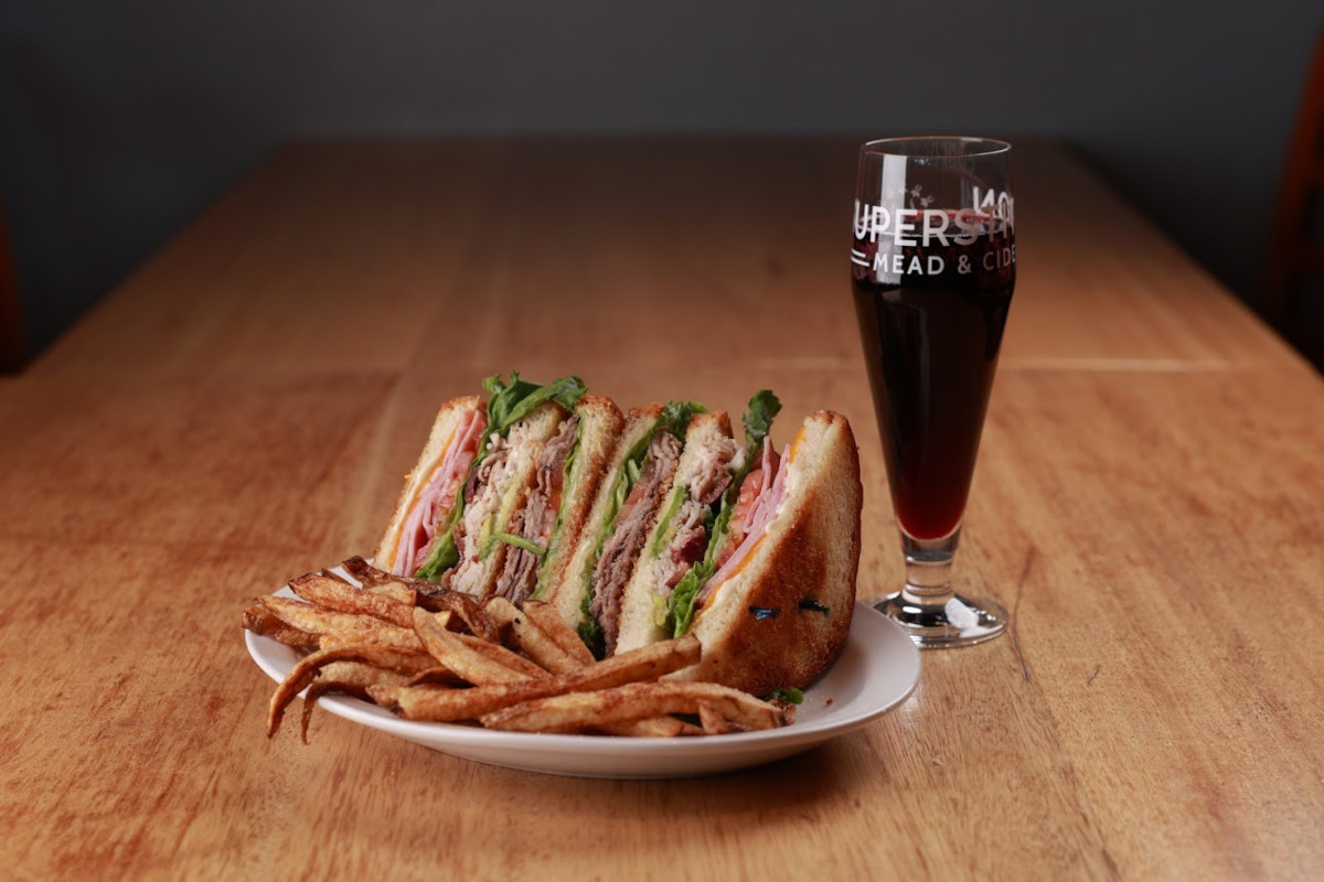 Sandwiches and fries, glass of red wine on the side