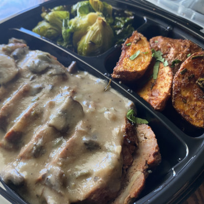 Steak with white sauce with potatoes takeout