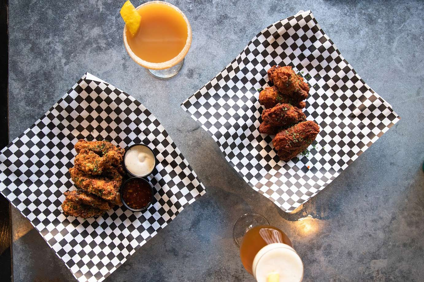 Fried chicken wings with beer and juice