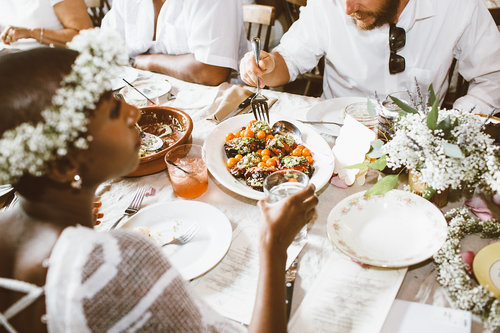 Wedding dishes, guests eating and drinking