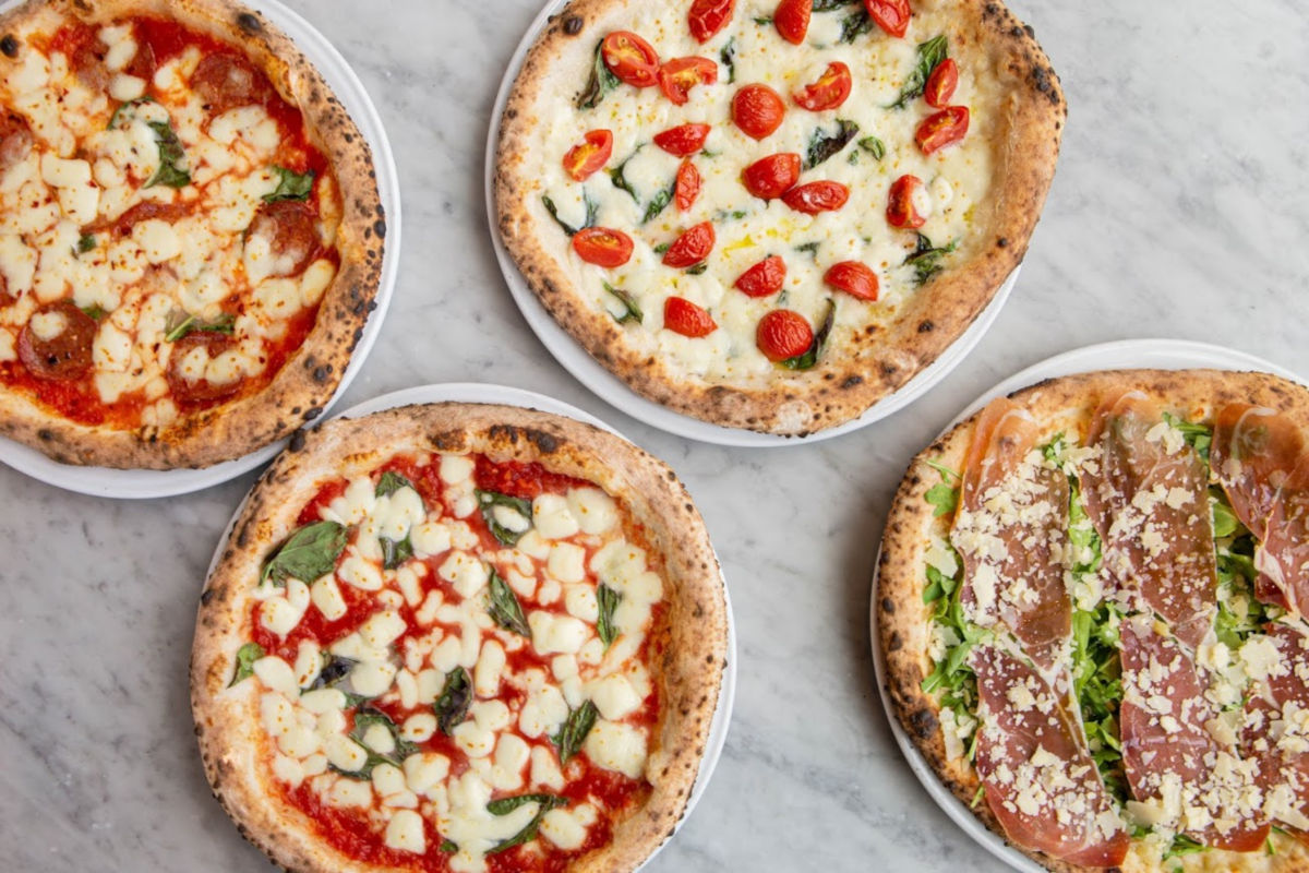 Four types of pizza, top view
