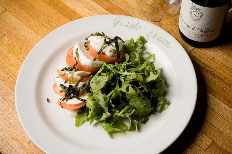 Capreze with mozzarella, tomatoes and greens