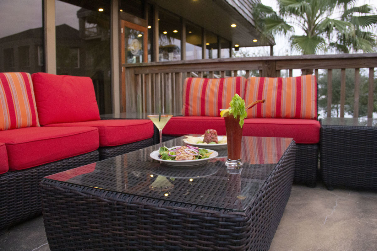 Restaurant exterior, two different meals, green and red cocktail on coffee table