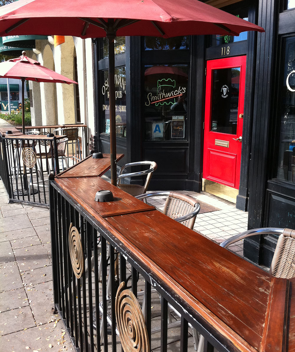 O'Sullivan's Irish Pub outside bar table with chairs