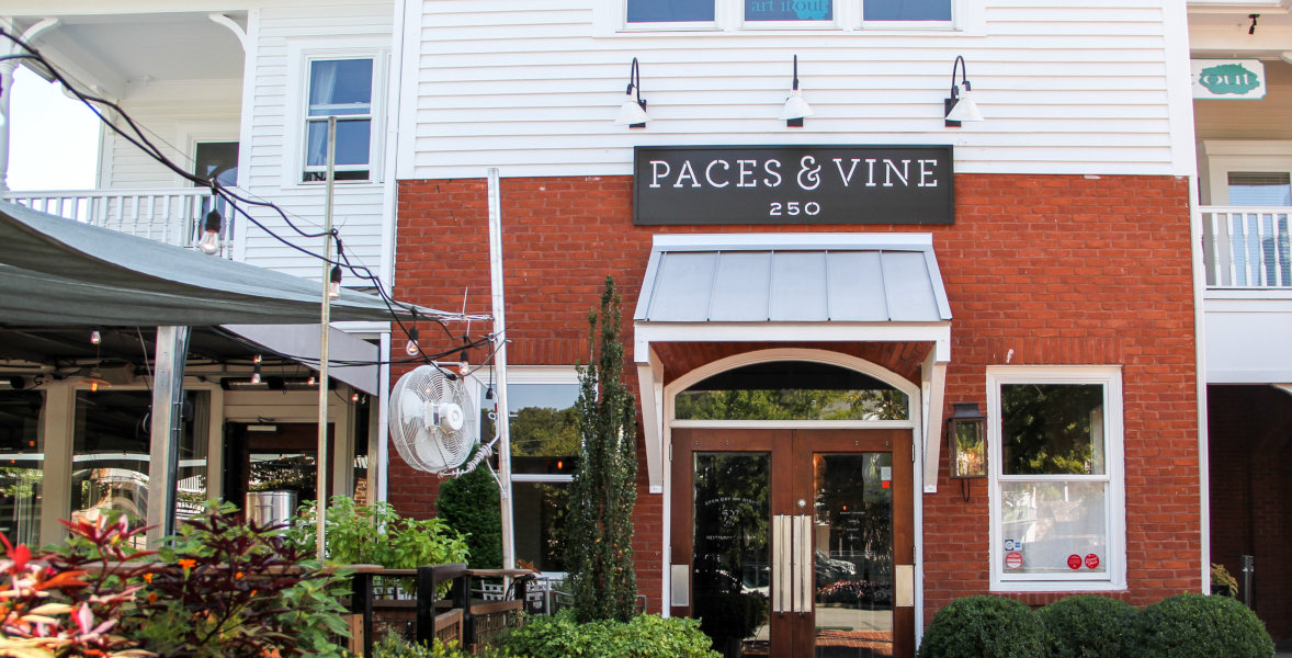 Paces and Wine entrance, red brick facade
