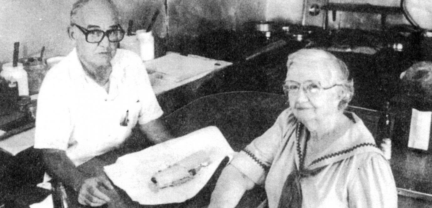 Interior, old photo of two guests eating sandwiches