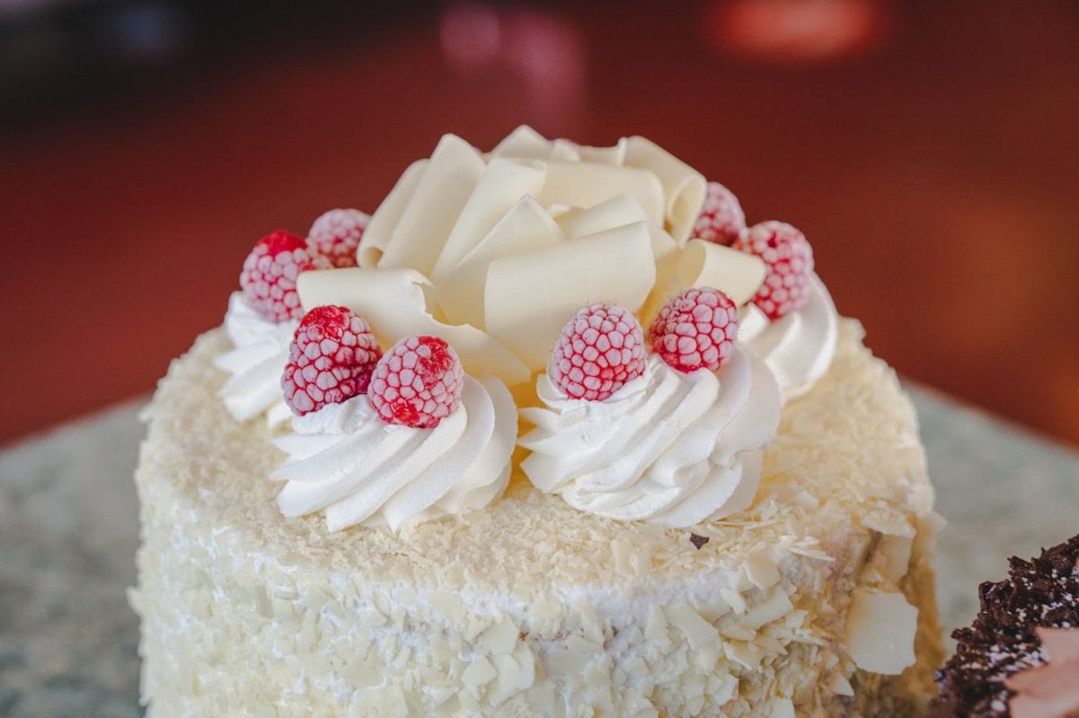 Dessert cake with cream on top