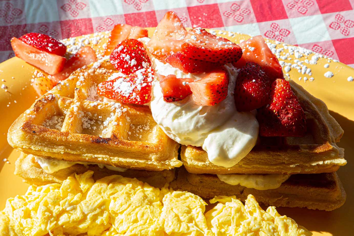 Waffle with cream and strawberries