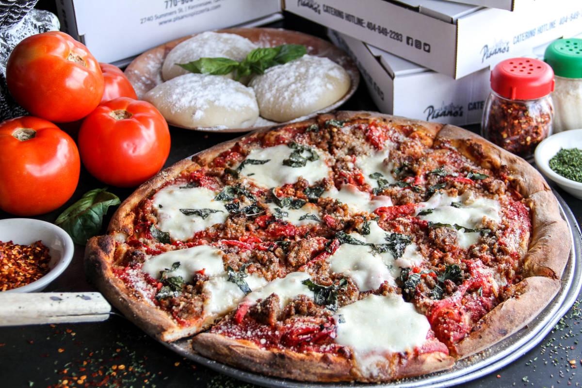 pizza with mozzarella, tamotos, stuffing