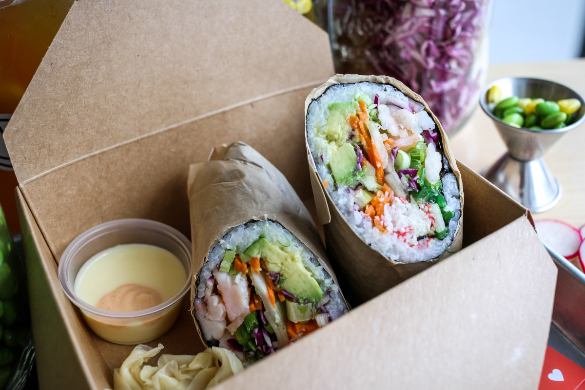 Rolled pastry with rice, meay and vegetables in the box