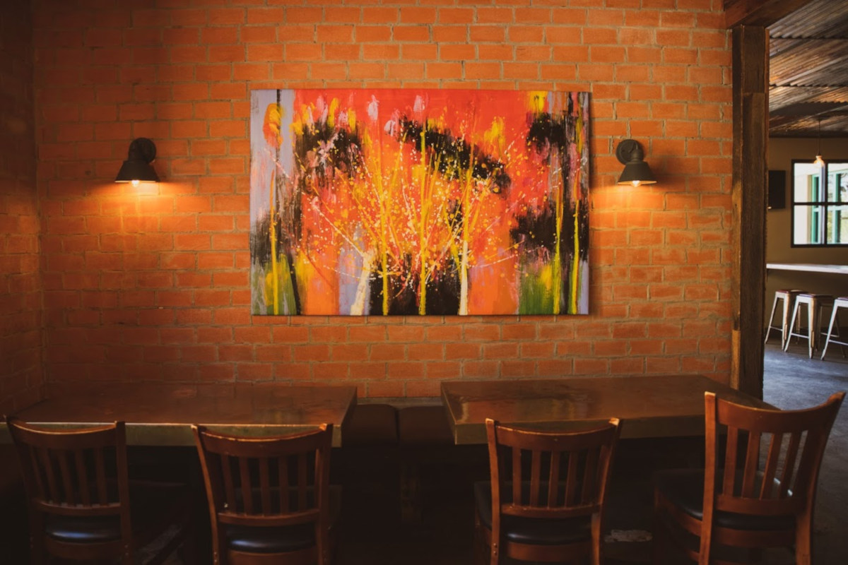 Interior, tables, painting on a brick wall