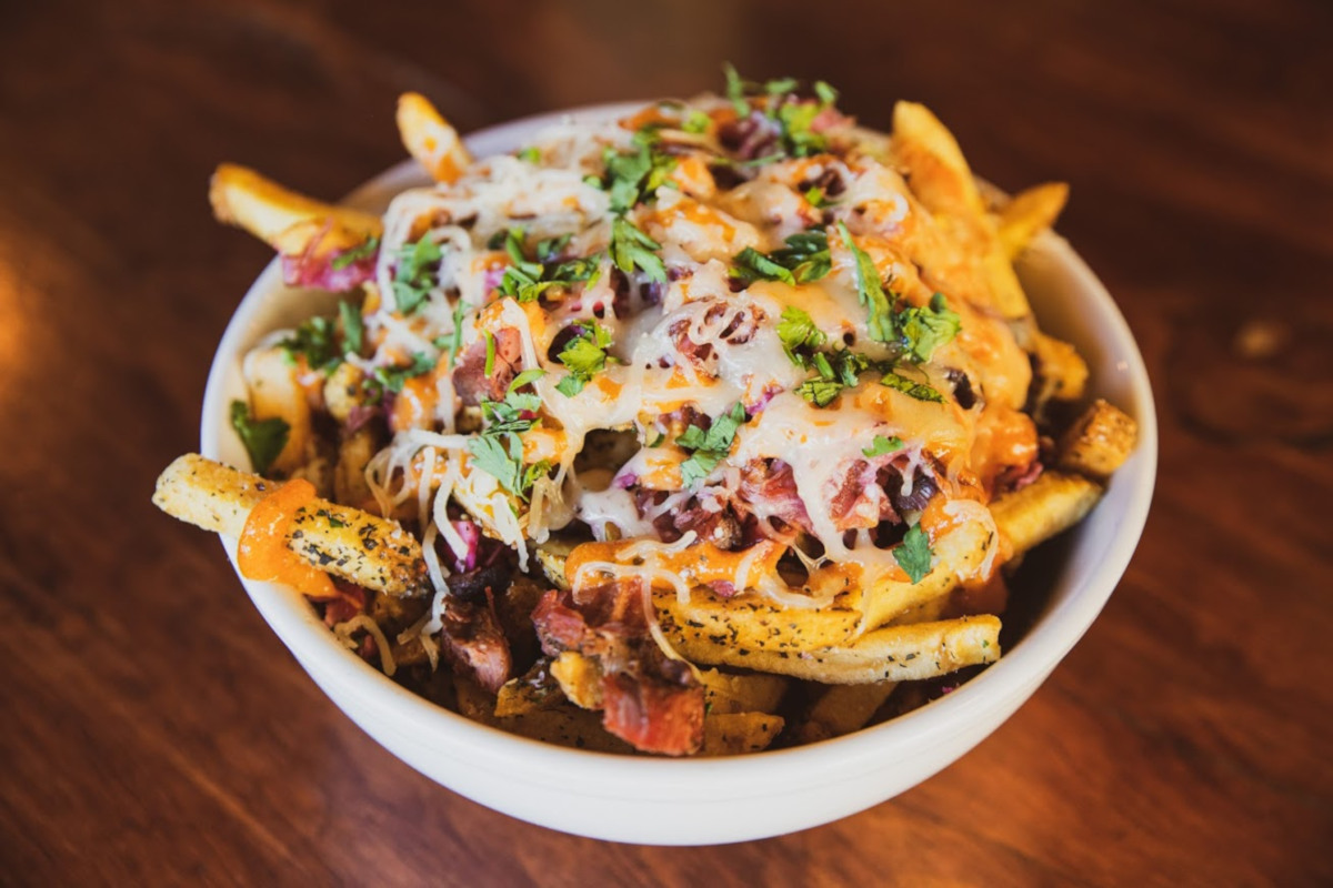 Fries topped with corn beef, dressing and kraut