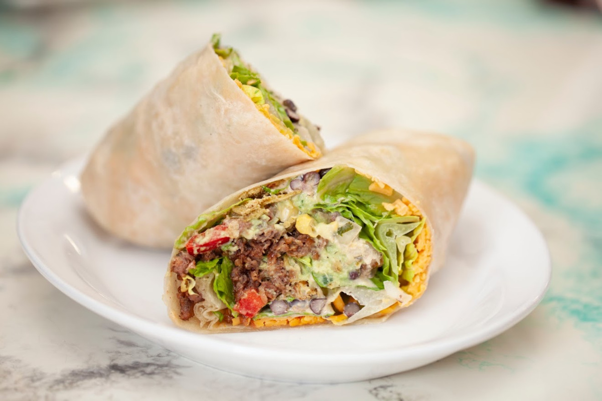 Black beans, roasted corn, red bell pepper, tomato, crunchy jalapenos and avocado wrap