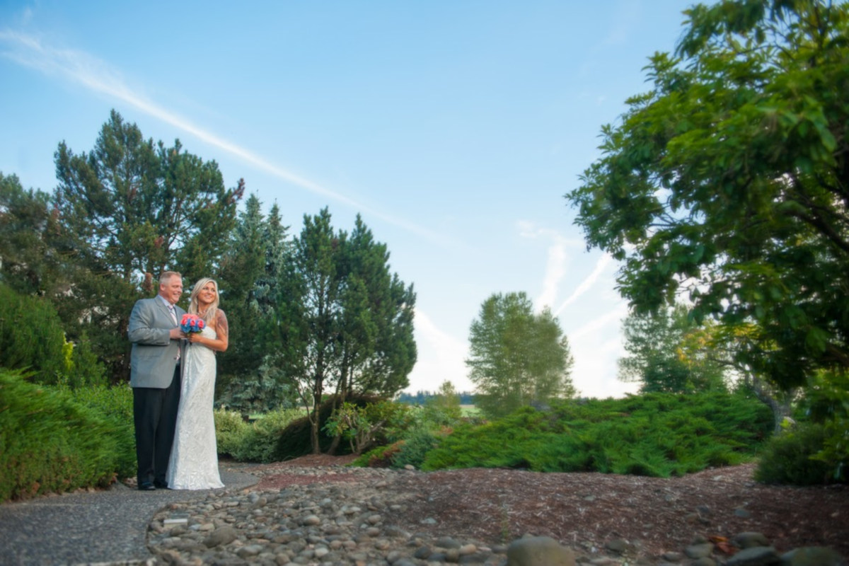 Exterior, wedding, bride and groom posing