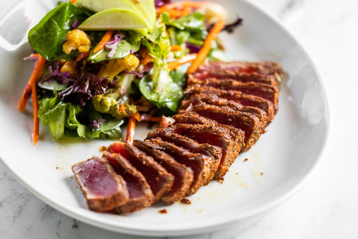 Sliced grilled meat and mixed salad