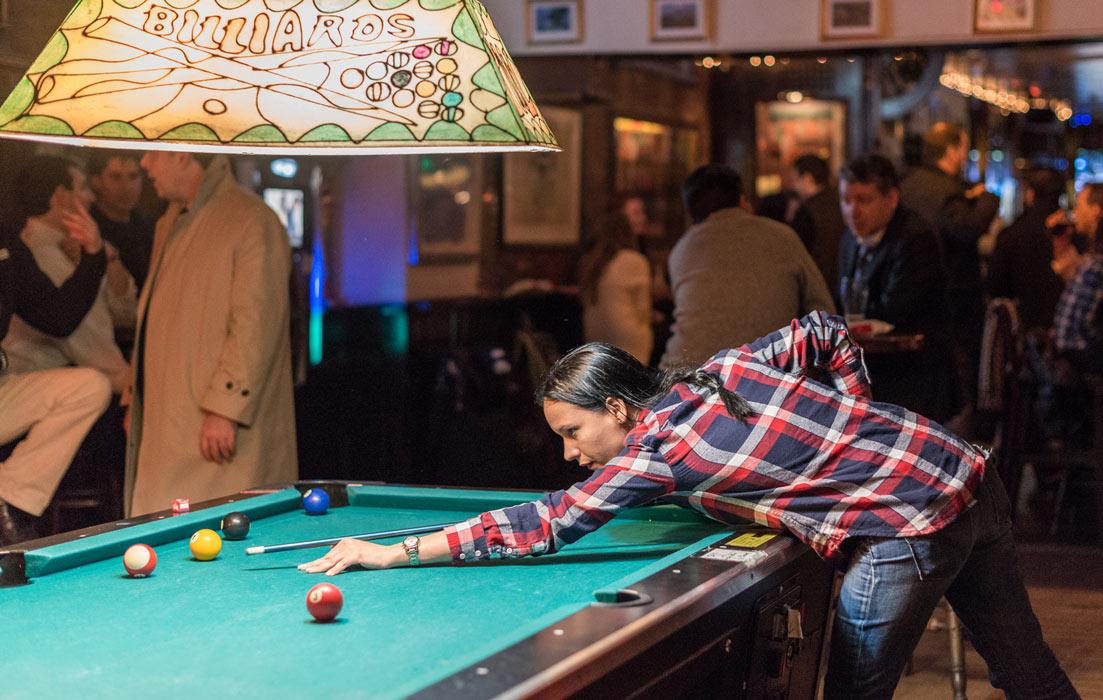 The girl plays billiards
