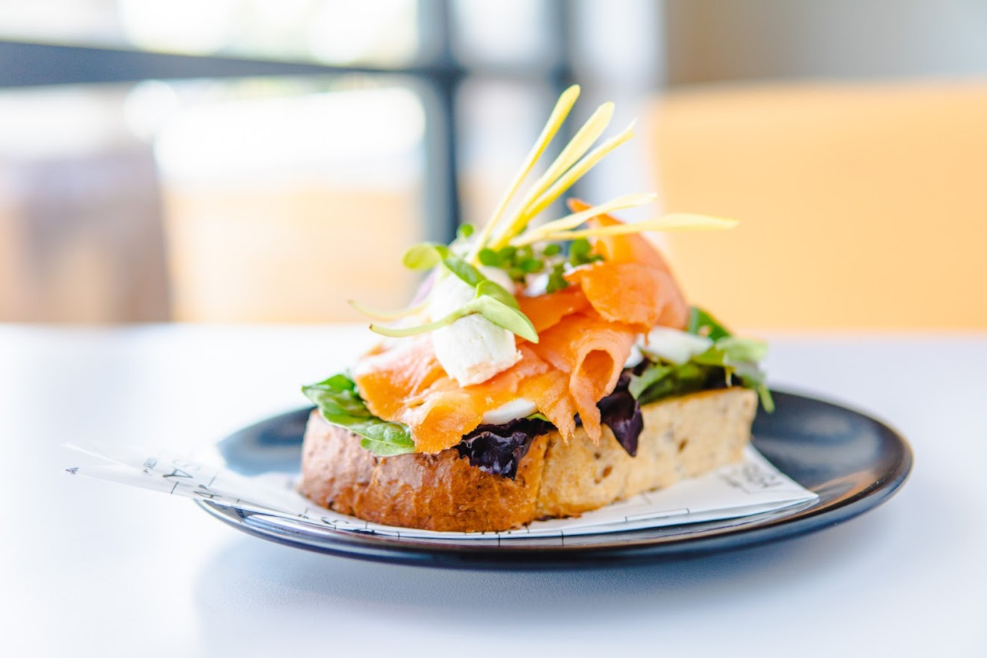 Slice of bread with veggies and salmon