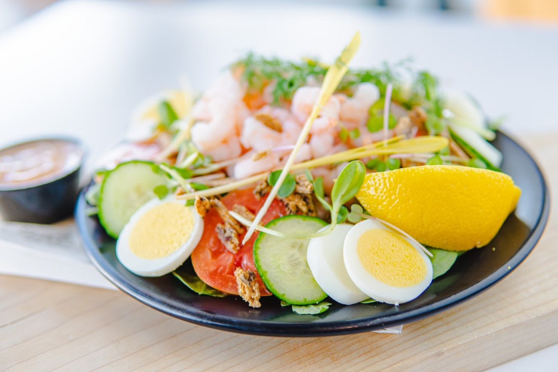 Cucumber, tomato, eggs, veggies, lemon and shrimp salad