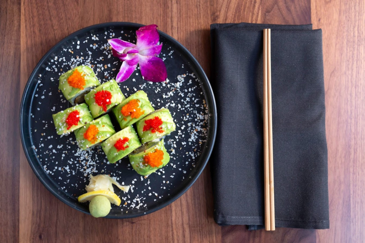 Sushi plate with a purple flower, top view