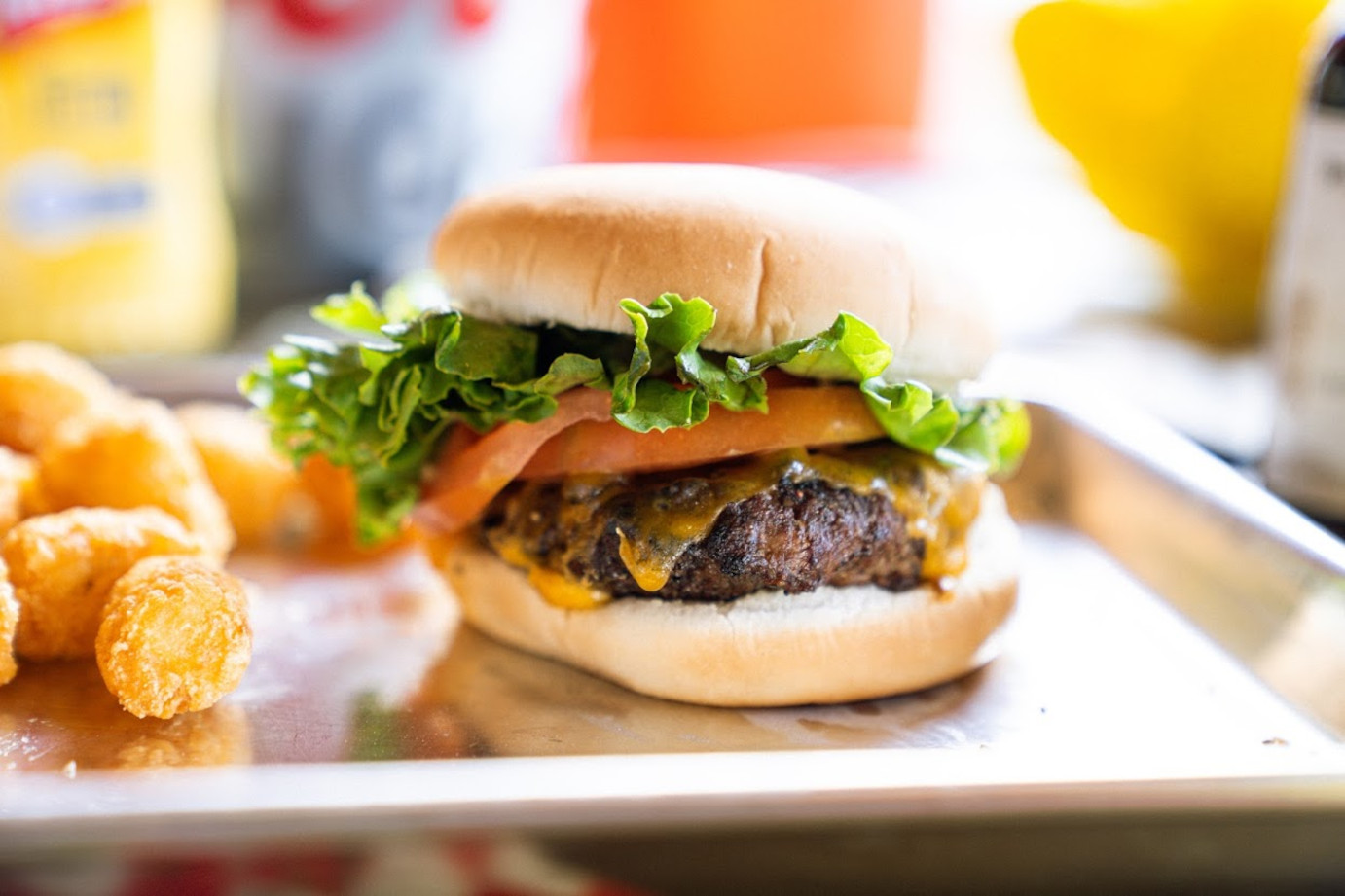 Cheeseburger with tomato and lettuce