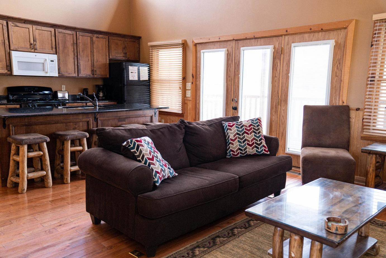 Cabin interior, comfortable couch, kitchen area