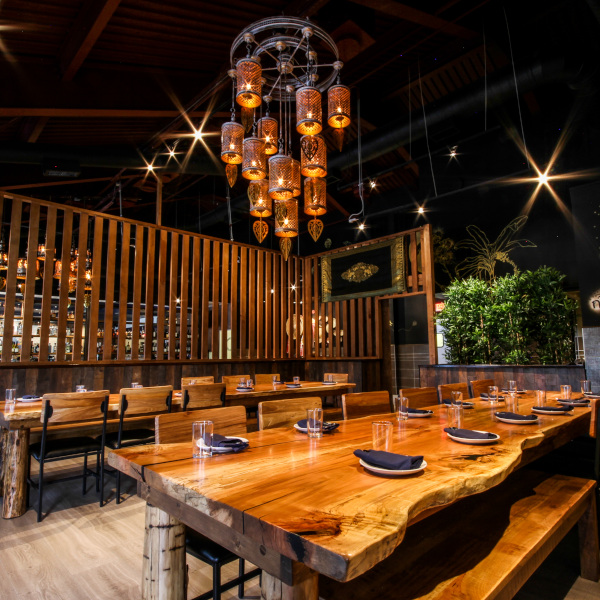 large wooden tables for more than 10 guests, oriental chandelier