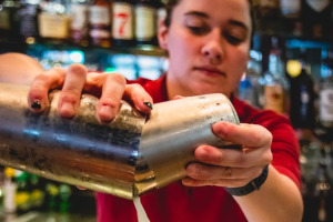 Staff member making cocktail