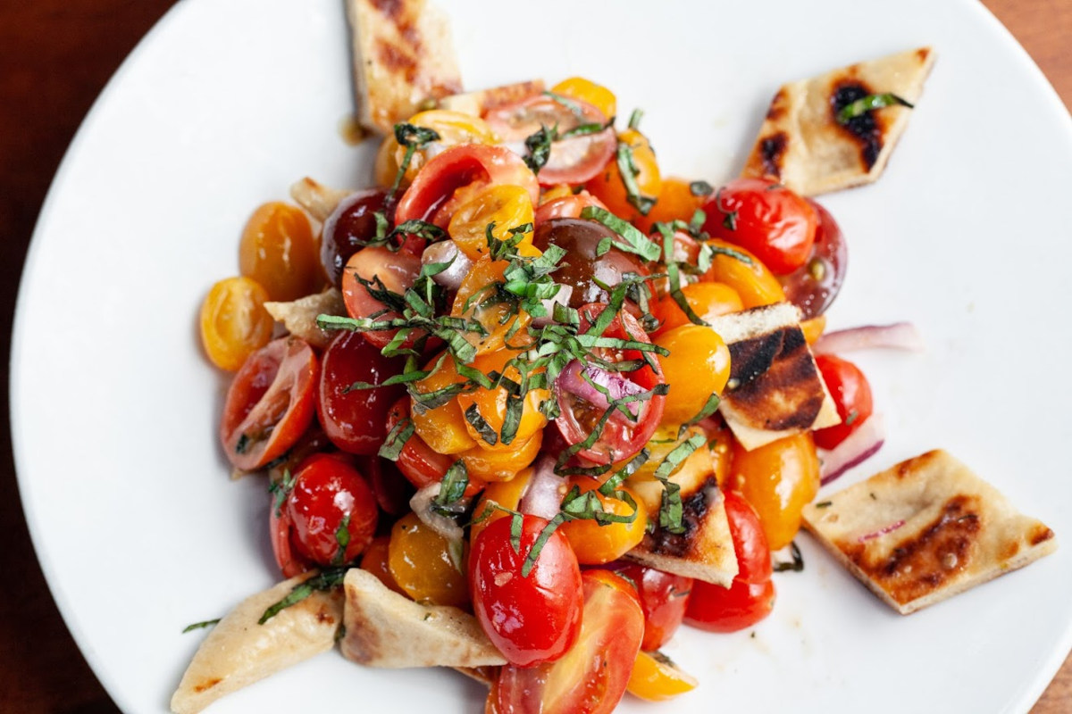 Toast salad with cherry tomato and parsley on top