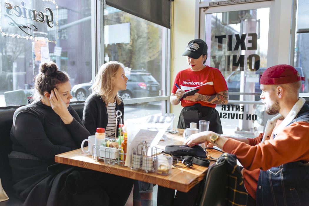 waitres talking an order