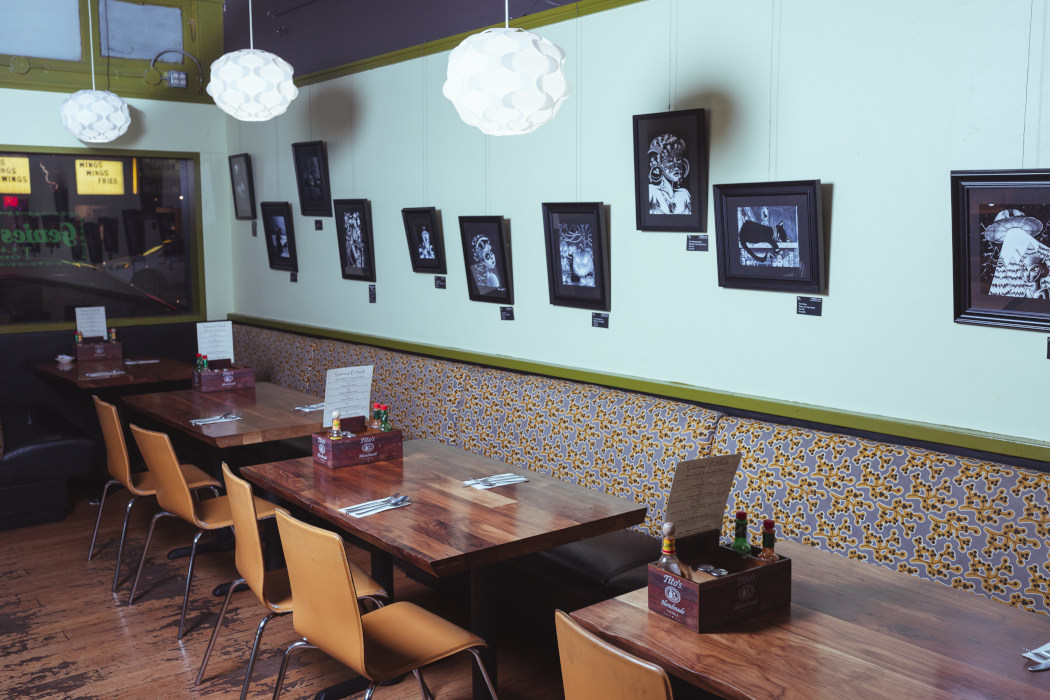 black and white pictures on the wall, dining area