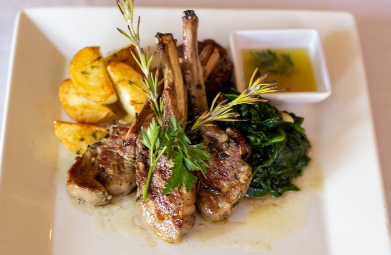Lamb rack, baked potatoes and greens