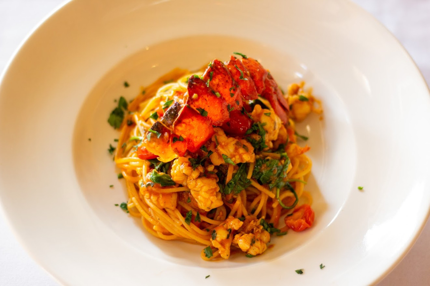 Spaghetti with lobster and parsley on top
