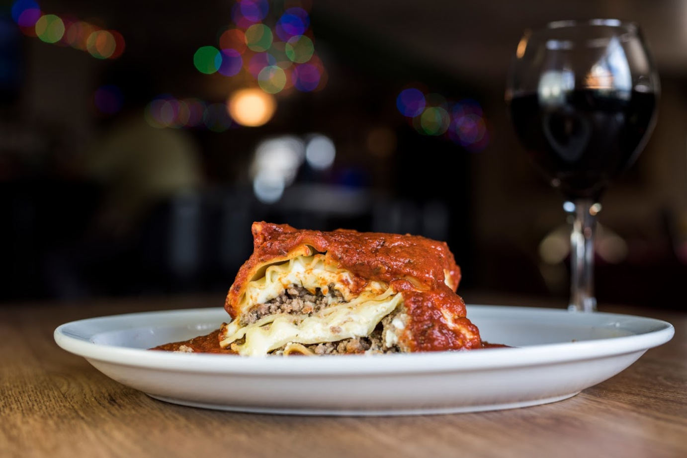 Lasagna and a glass of red wine
