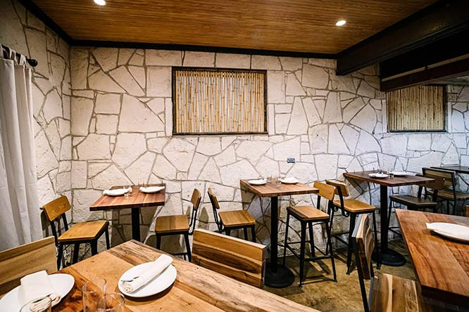 Tables in a stone wall room