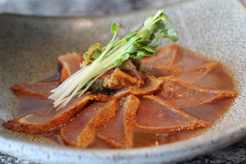 Fresh island albacore, cajun seared, served in a warm garlic, serrano chili, cilantro