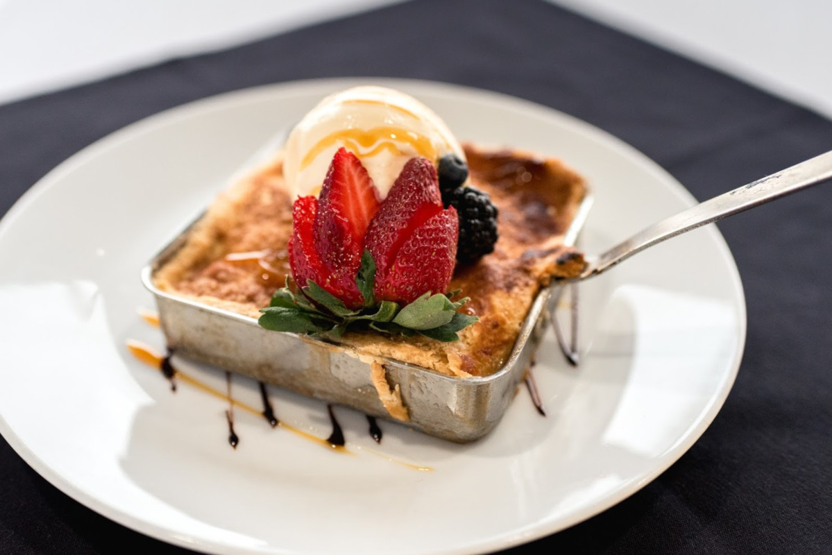 Seared dessert with berries and ice cream