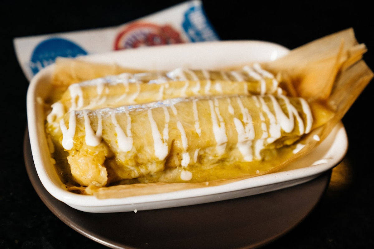 Fresh corn masa tamales drizzled with roasted chilaca, cream and cheese