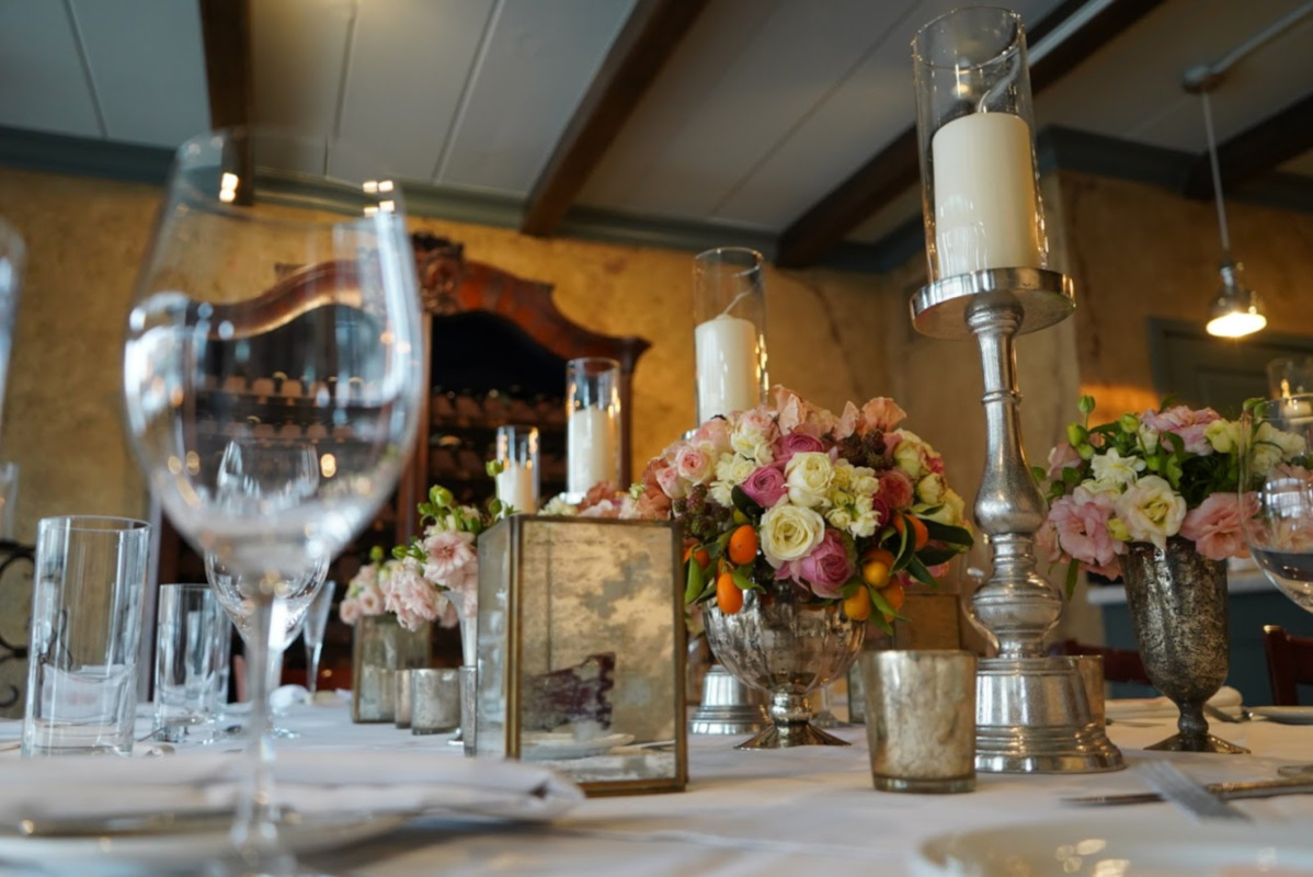 Interior, table with flower decoration, closeup