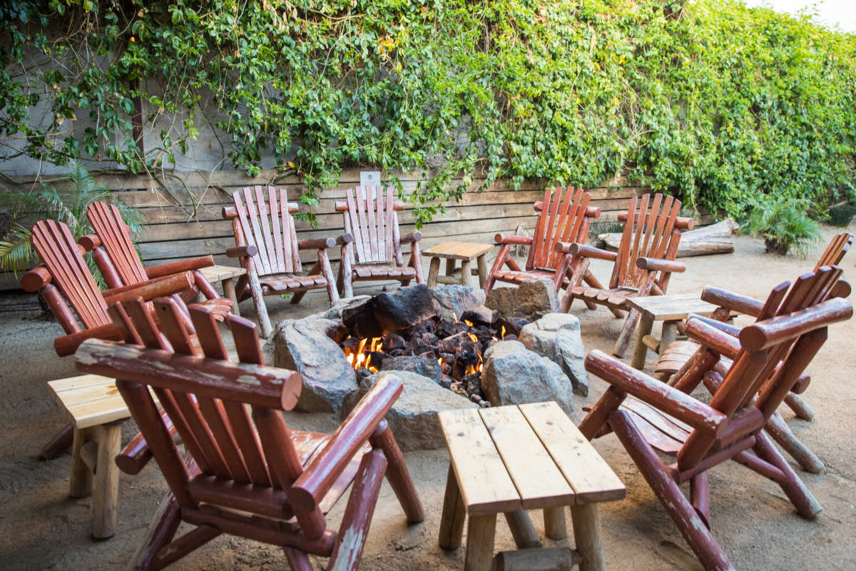 Restaurant exterior, chairs around fire place