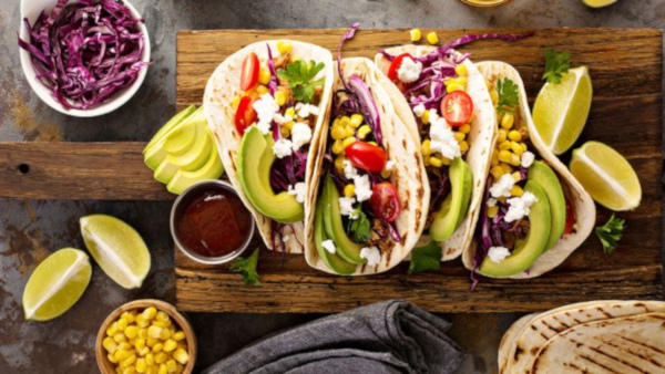 veggie tacos on a wooden board