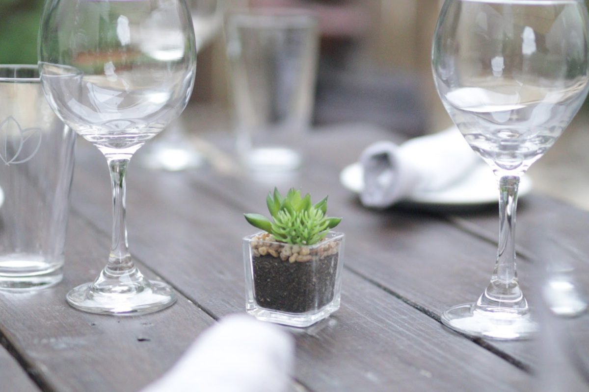 Outdoor, two wine glasses on the table and decoration