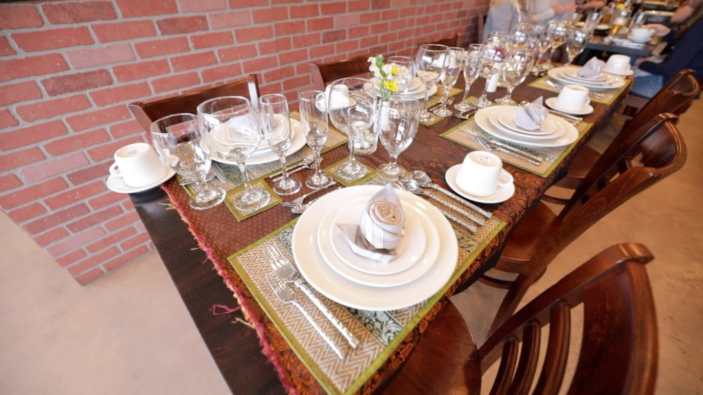 Indoor, table with dishes and glasses