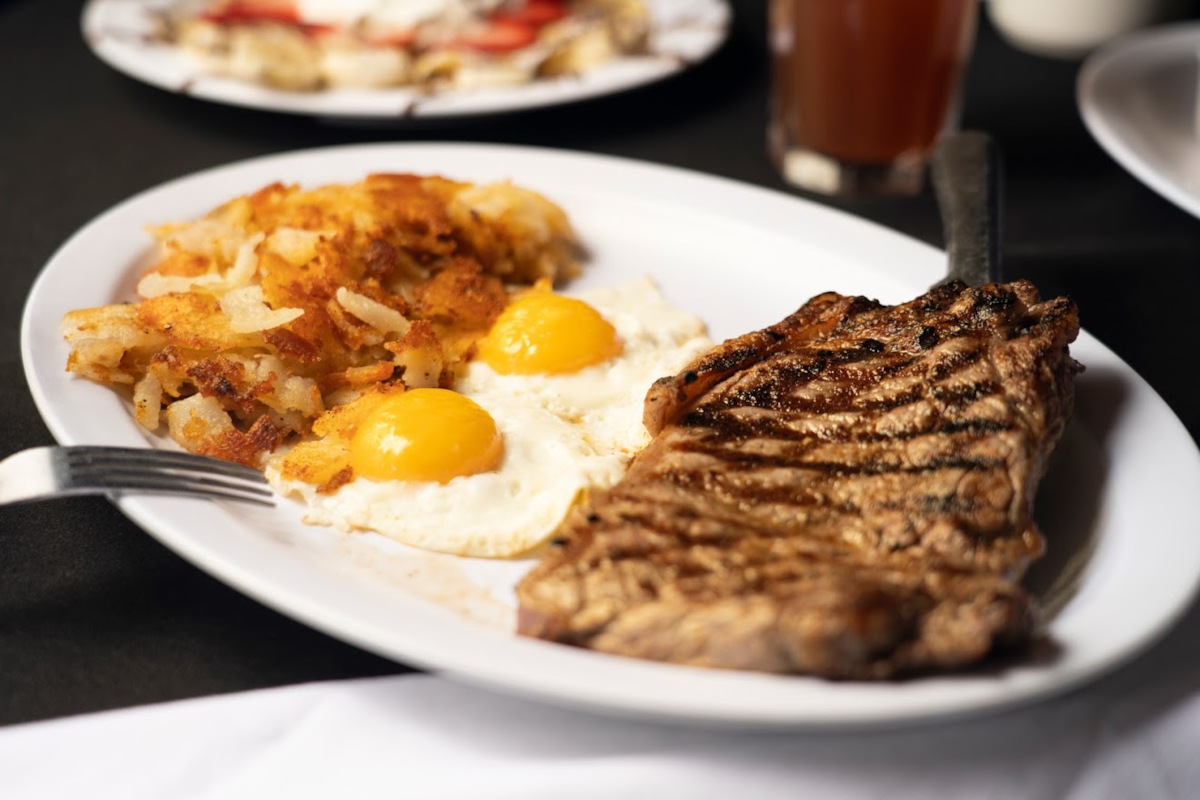 Grilled meat and fries eggs