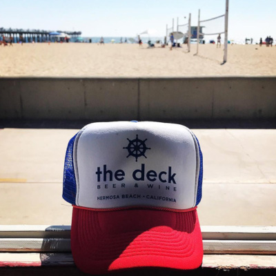 deck red white and blue hat on a bank