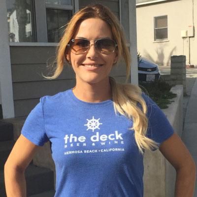 woman wearing a blue deck t-shirt
