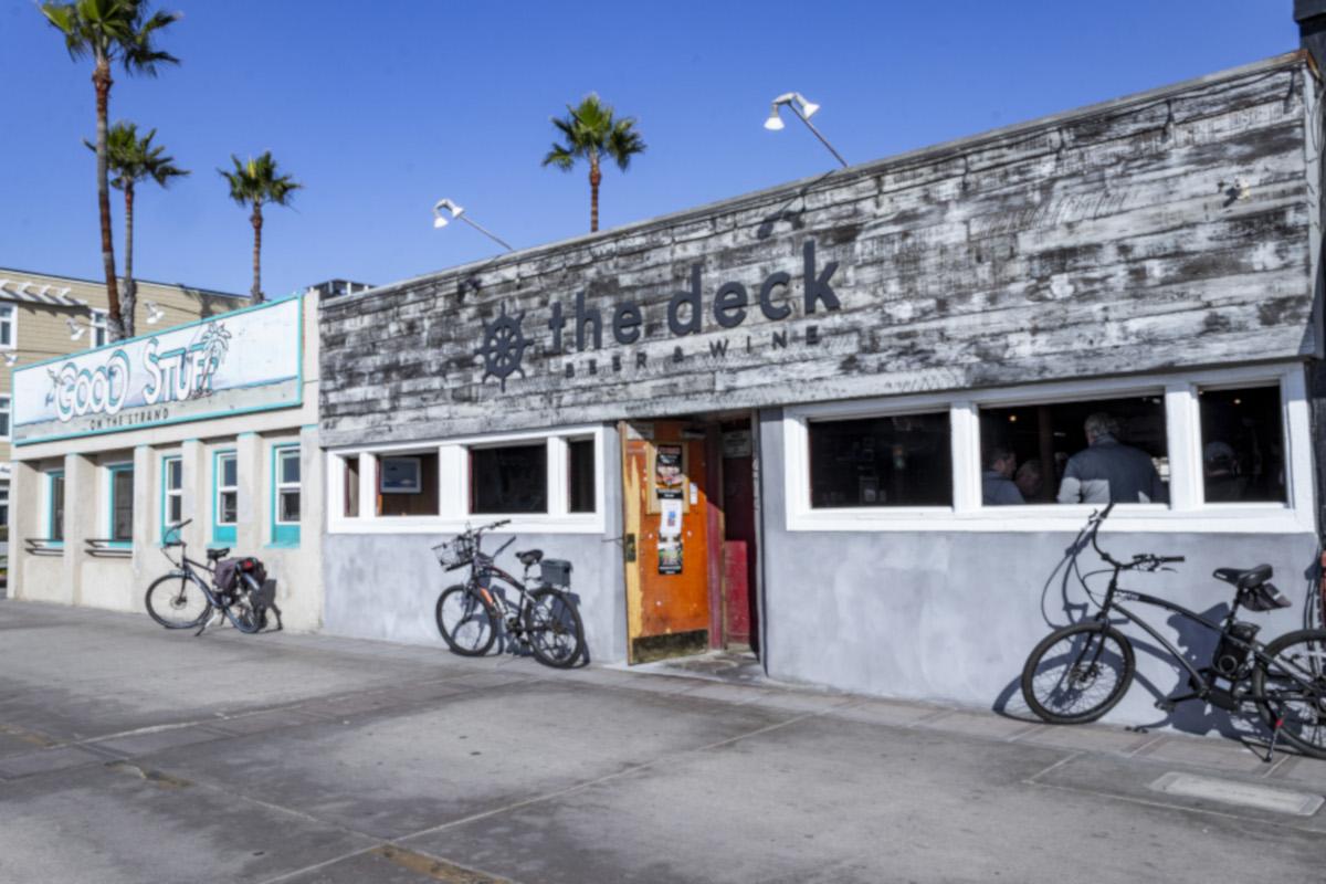 outdoors, three bikes, rudder shaped logo
