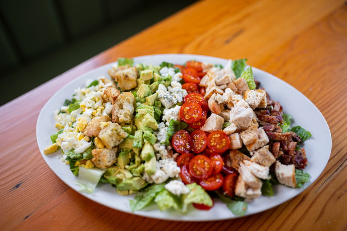 Eggs, lettuce avocado, croutons, cherry tomato, chicken and bacon salad
