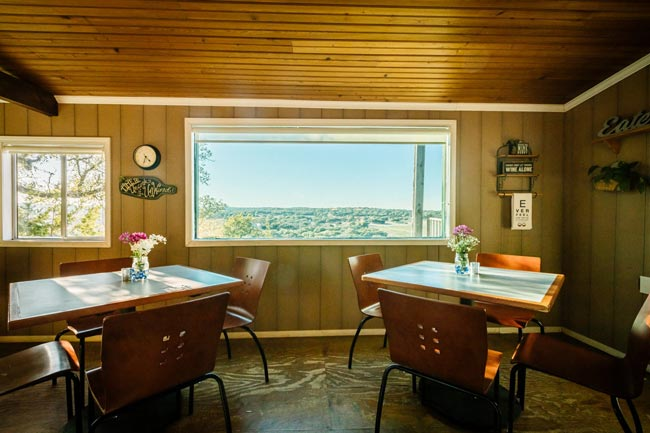 indoor tables beside the window with the panoramic view