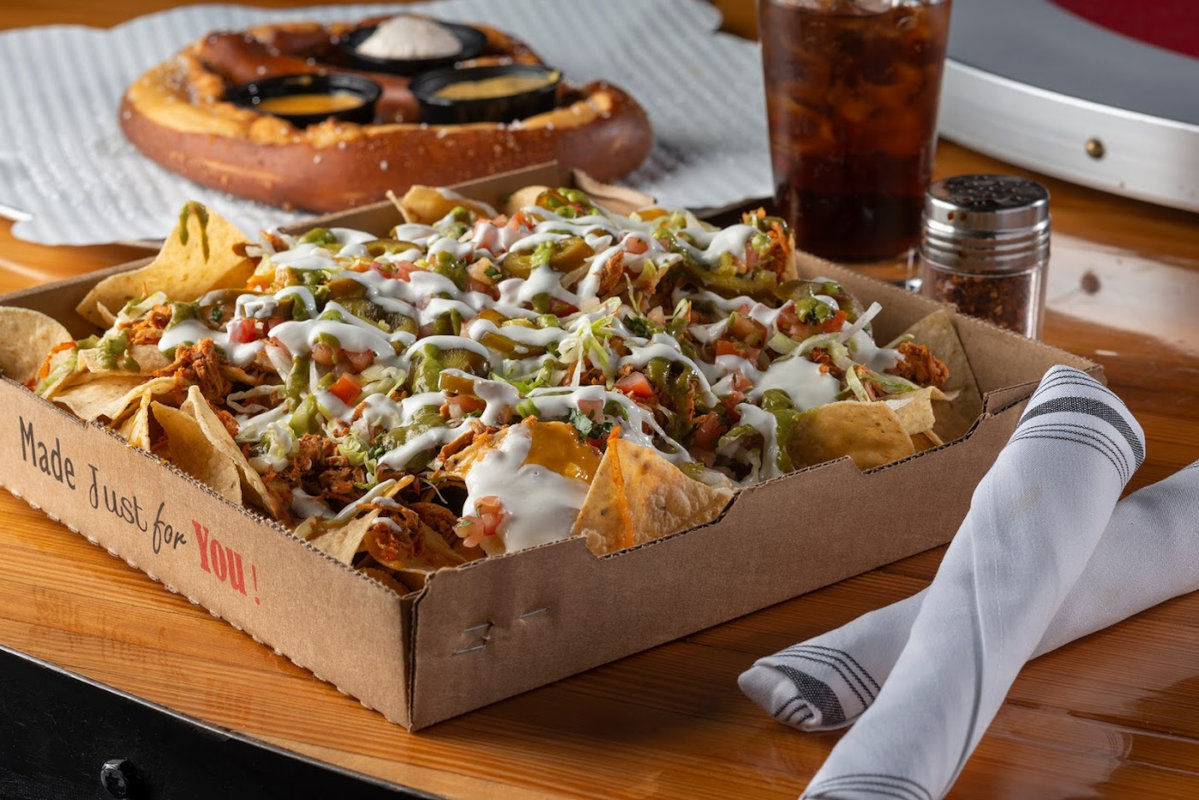 Nachos topped with choice of picadillo beef or chipotle chicken tinga