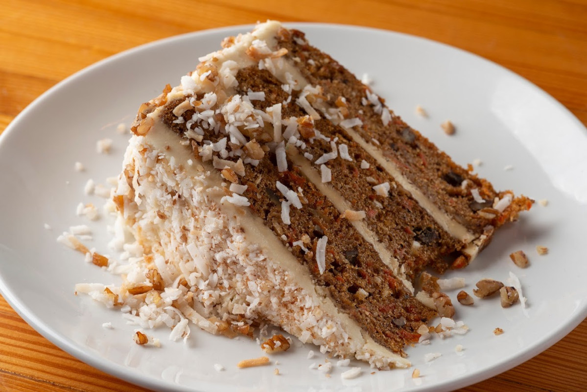 Cake with carrots, pecan, pineapple, and coconut combine
